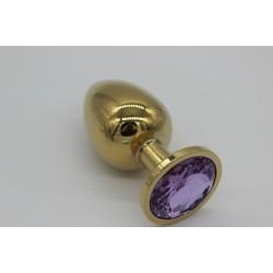 Złoty korek analny z fioletowym kryształem rozmiar M